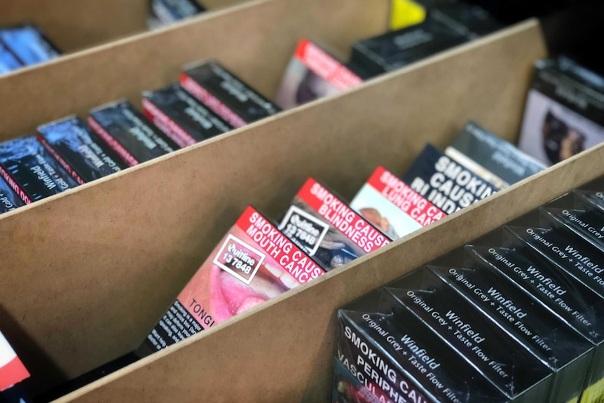 A draw filled with cigarettes in plain packaging.