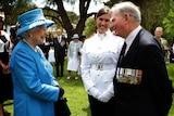 Queen Elizabeth is greeted by Arthur 'Bushy' Pembroke and his Granddaughter Staff Cadet Harriet Pembroke