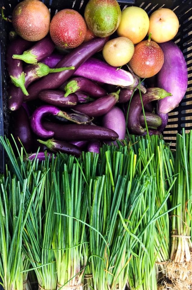 A photo of fresh pick fruit and vegetables in a box.