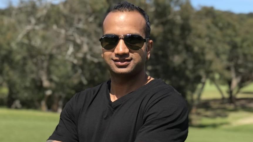 Lovepreet Sharma looks at the camera outdoors