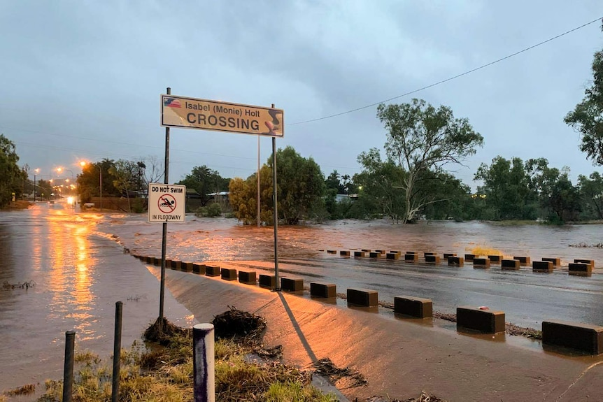 A road crossing with water rushing over it.