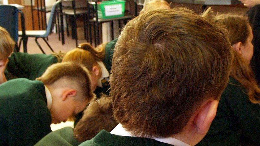 Primary school children work in a classroom