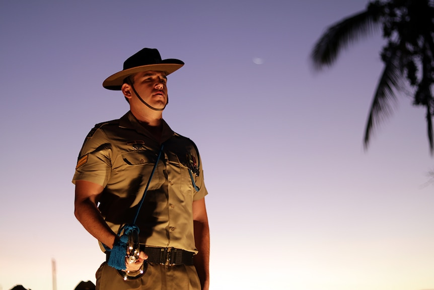 A soldier stands to attention at the dawn service in Townsville.
