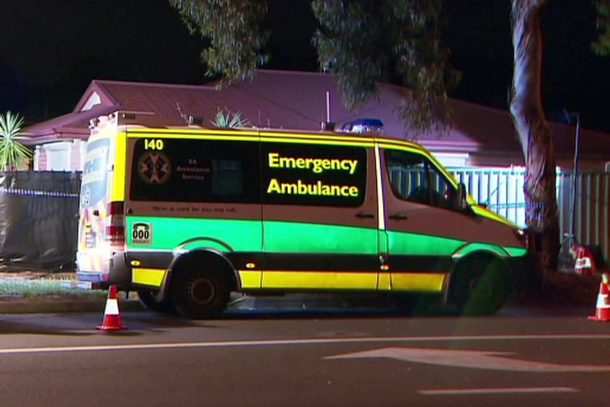 An ambulance outside a house at night