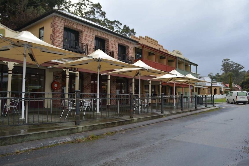 Empty outdoor dining areas in Strahan Village on Tasmania's West Coast