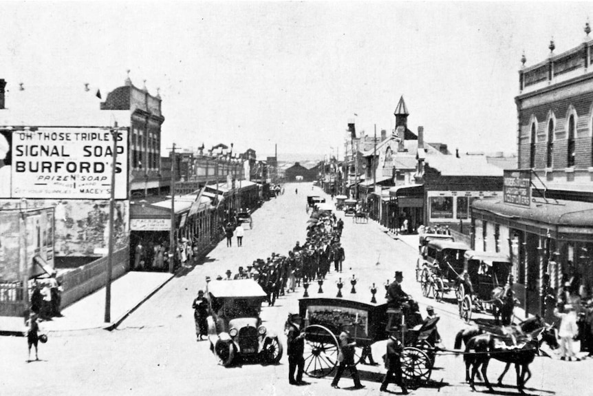 Bishop William Bernard Kelly's funeral procession, with the coffin pulled by a horse.