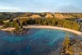 Aerial photo of Norfolk Island showcasing bright blue swimming bay called Emily Bay.