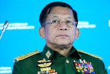 Commander-in-Chief of Myanmar's armed forces Min Aung Hlaing  wears a green uniform with golden insignia