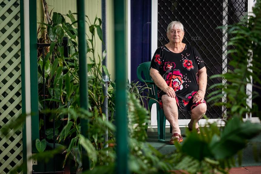 Lynn Archibald sits on the deck outside her caravan at the Malak Caravan Park.