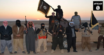 ISIS militants wave flags