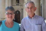 Jen and Ken Barnes standing on the steps of Victoria's parliament