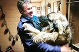 A big dog called Arden giving his owner a hug.
