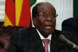 Robert Mugabe delivers his speech during a live broadcast at State House in Harare.