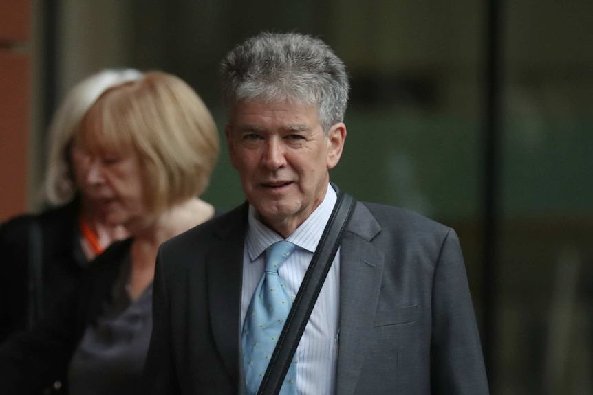 Michael Staindl, a man in a grey suit, outside the Federal Court in Melbourne.