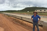 Cattle producer standing next to weighbridge