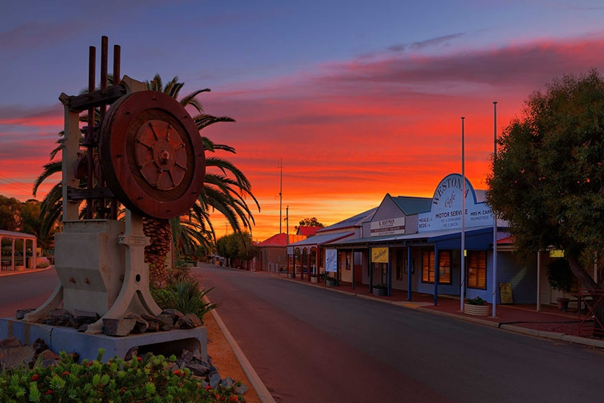 Looking down the main street and the shops of Westonia in Western Australia's eastern wheatbelt at sunset