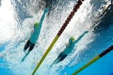 Two Australians swimmers competing in the heats of the 400 metres freestyle at the Tokyo Olympics.
