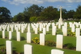 Rows of white headstones in a cemetery in Kedron, Brisbane.