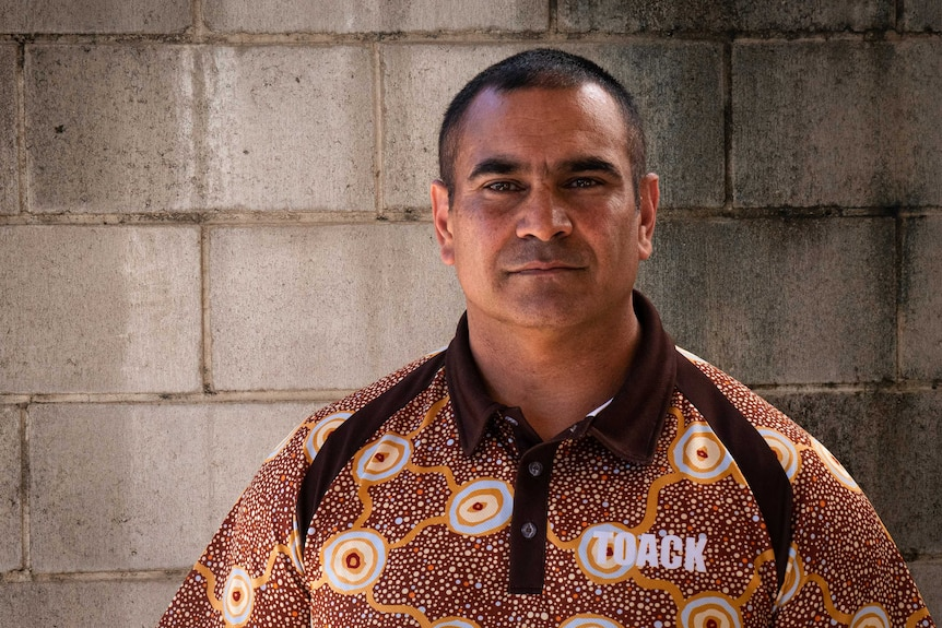 Ngunnawal man Richie Allan standing in front of a concrete wall