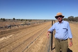 Jack Banks with the wild dog fence being built on his land