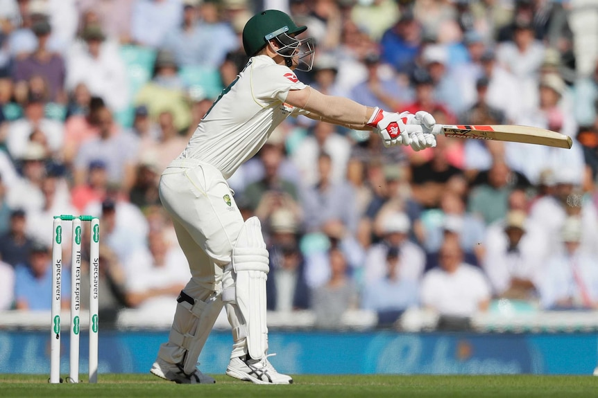 David Warner reaches a long way outside his off stump and flashes the bat at the ball.