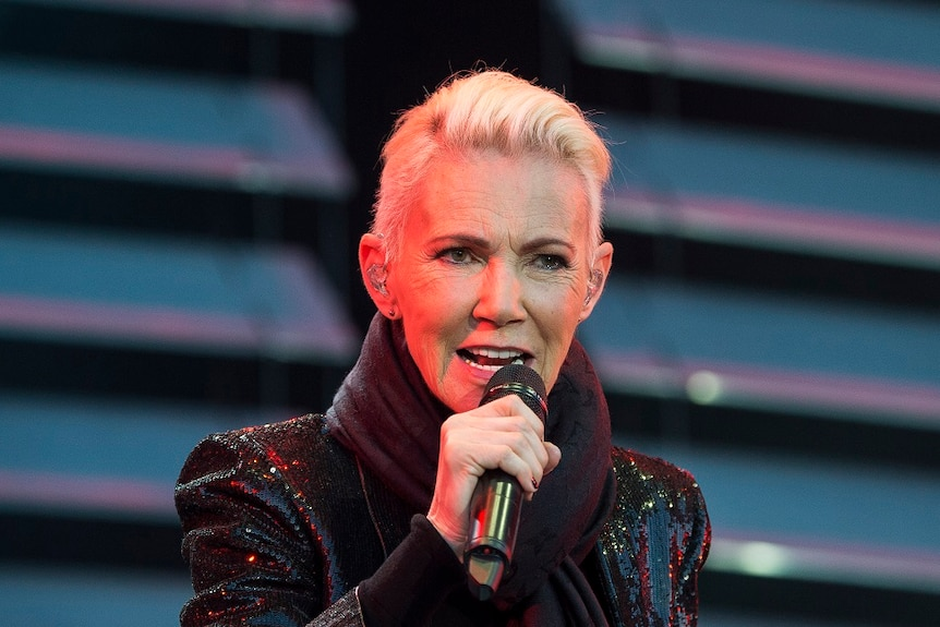 Marie Fredriksson, singer of the pop duo Roxette singing on stage.