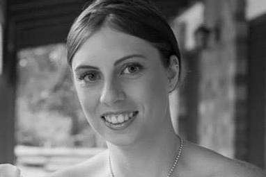 Black and white wedding photo of murder victim Kelly Wilkinson smiling.