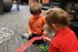 Luka Pamphilon playing with his sister Mia