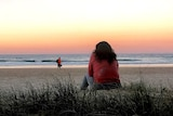 """""""Jayne"""" stares at the sunset on a Gold Coast beach"""