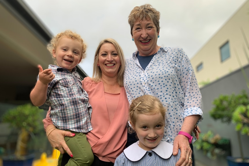 Amanda Rotturo (centre) with her children and Mary Gill.