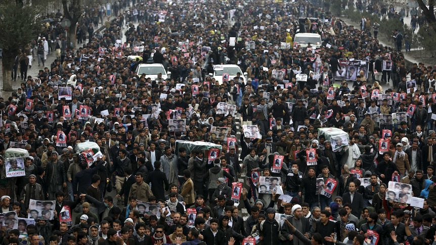 People attend a protest in Kabul against the killing of seven members of the Hazara minority