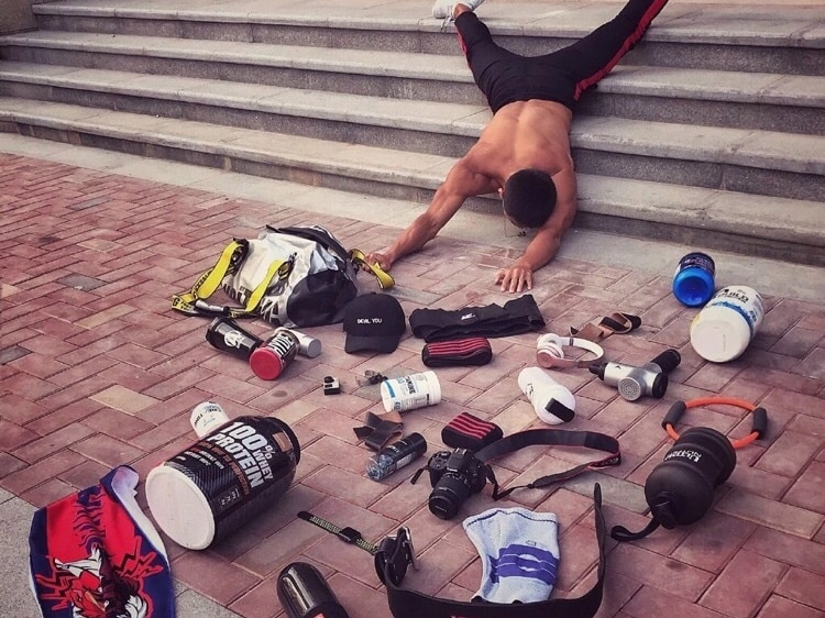 A Chinese man posed for the challenge with all his spots-related items on the ground, while he was lying face down on the stairs