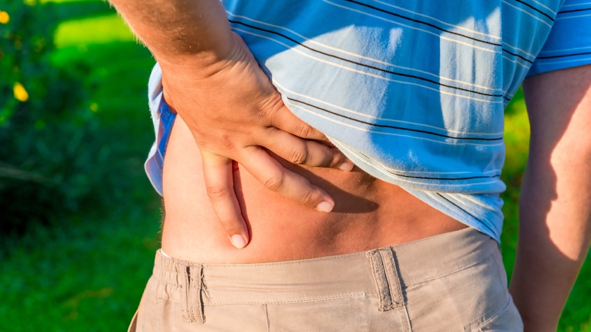 Man holding his hand sore lower back