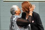 Gillard greets Donoghue in Parliament