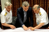 Argentina's President Mauricio Macri listens to Admiral Marcelo Srur