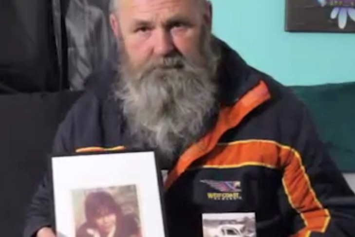 Crash survivor Michael Boyd holds photos of his best friend and the car crash that took his life.