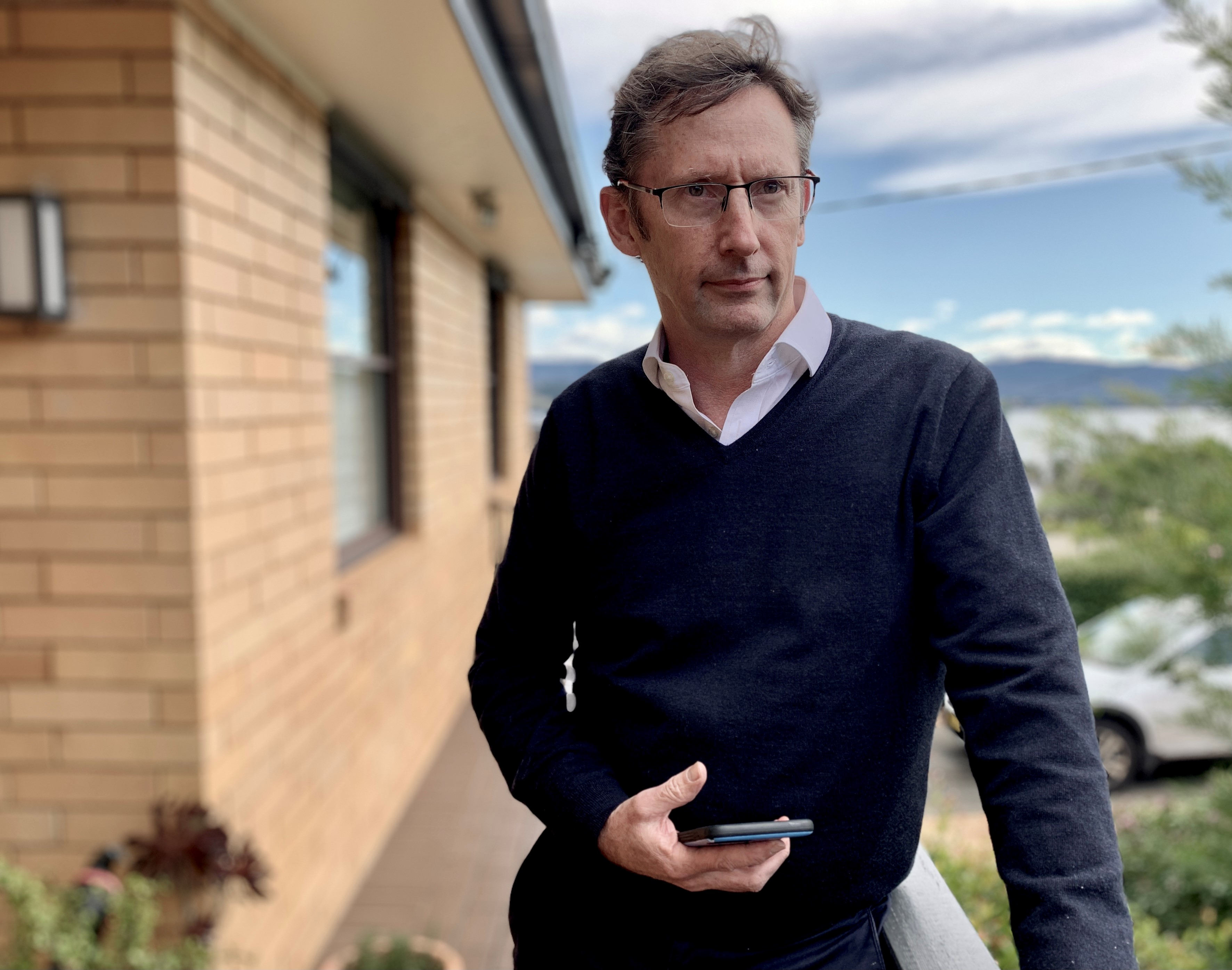 Stephen Jones outside his home in NSW.