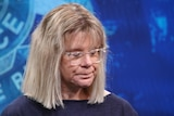A photo of Jason Langhan's mother at a press conference.
