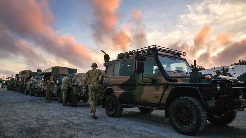 Soldiers and trucks