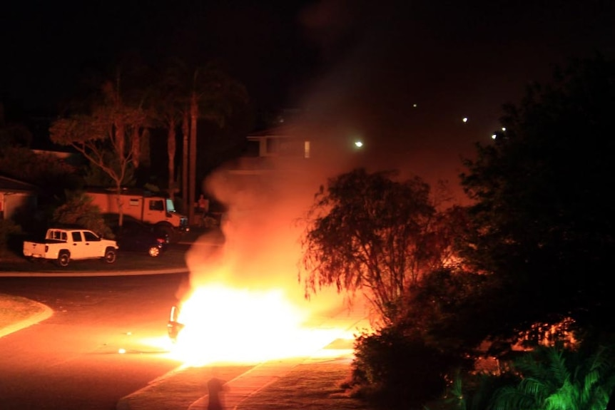 A car allegedly used in the robbery of an ATM burns.