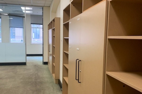 An empty office with empty shelves.