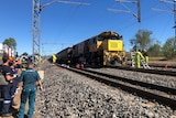 Emergency services staff and coal train involved in a collision with another locomotive near Westwood, west of Rockhampton.