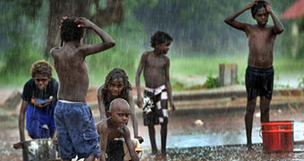 Aurukun youngsters play in the rain.