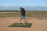 Male golfer teeing off on Nullarbor Links golf course