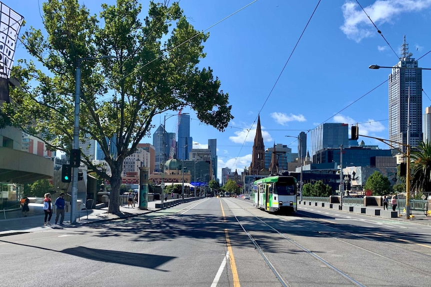 Wide shot of Melbourne by tram and just a few people.