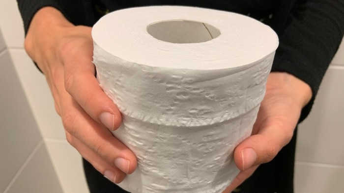 a roll of toilet paper being held close to the camera