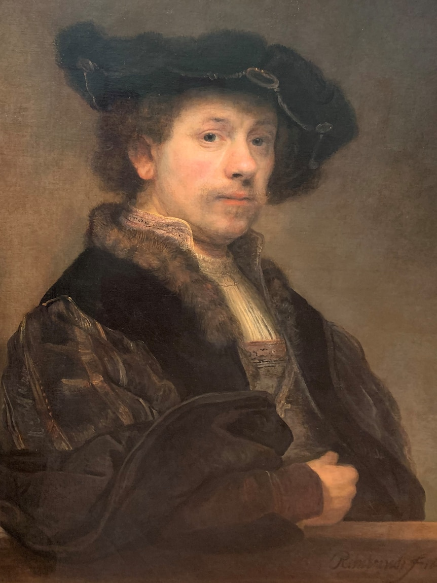 The portrait shows Rembrandt wearing a hat and looking wistfully into the distance, wearing garb from that era.