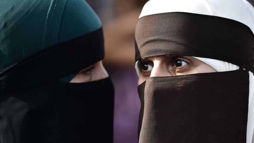 Two women wearing burkas.