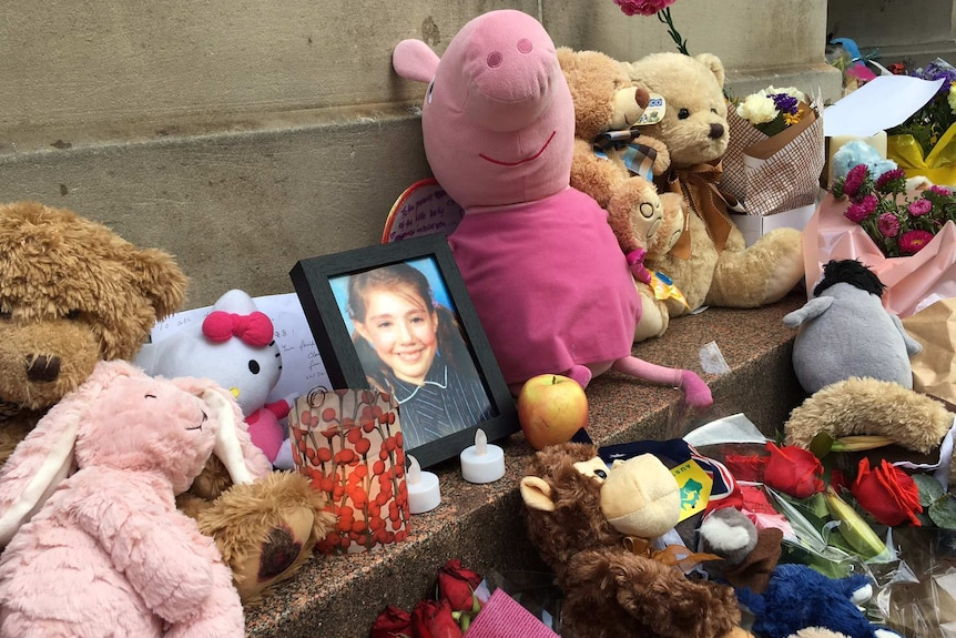 A photo of 10-year-old Thalia Hakin at a memorial for the victims of the Bourke St car attack.