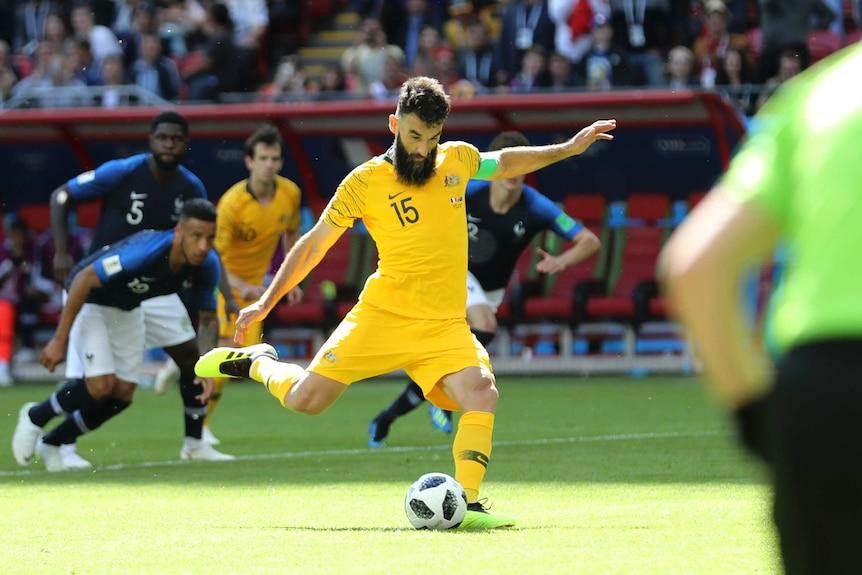 Mile Jedinak converts Australia's penalty against France